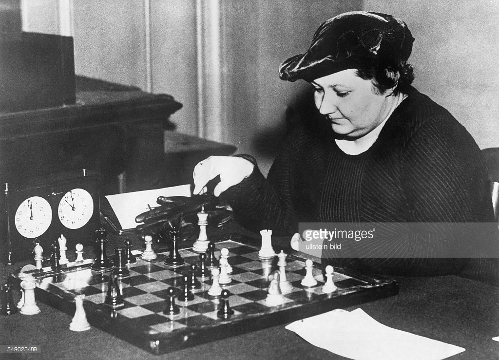 Vera Menchik in a pre-event posed picture in which she faces unstoppable checkmate in one from Hastings 193? She was about to play Sir GA Thomas.