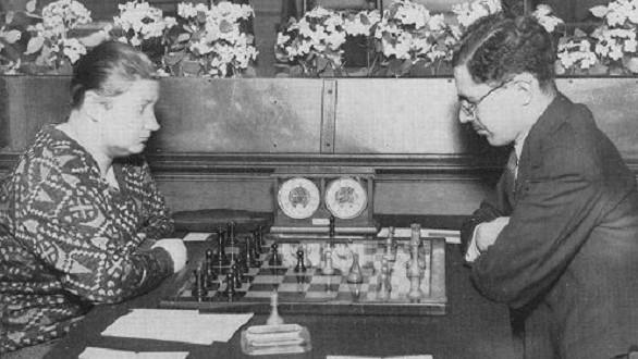 Isaac Kashdan plays Vera Menchik during the Hastings Congress on December 28th, 1931. Kashdan won in 45 moves in a classical French.
