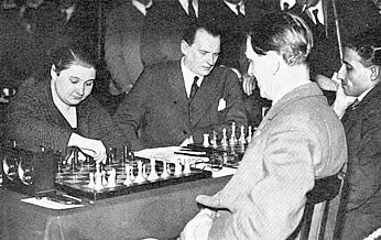 From left to right: Vera Menchik, Alexander Alekhine, Géza Maróczy and Sultan Khan. From London International Masters, 1st February, 1932, French Defence, drawn in 32 moves.