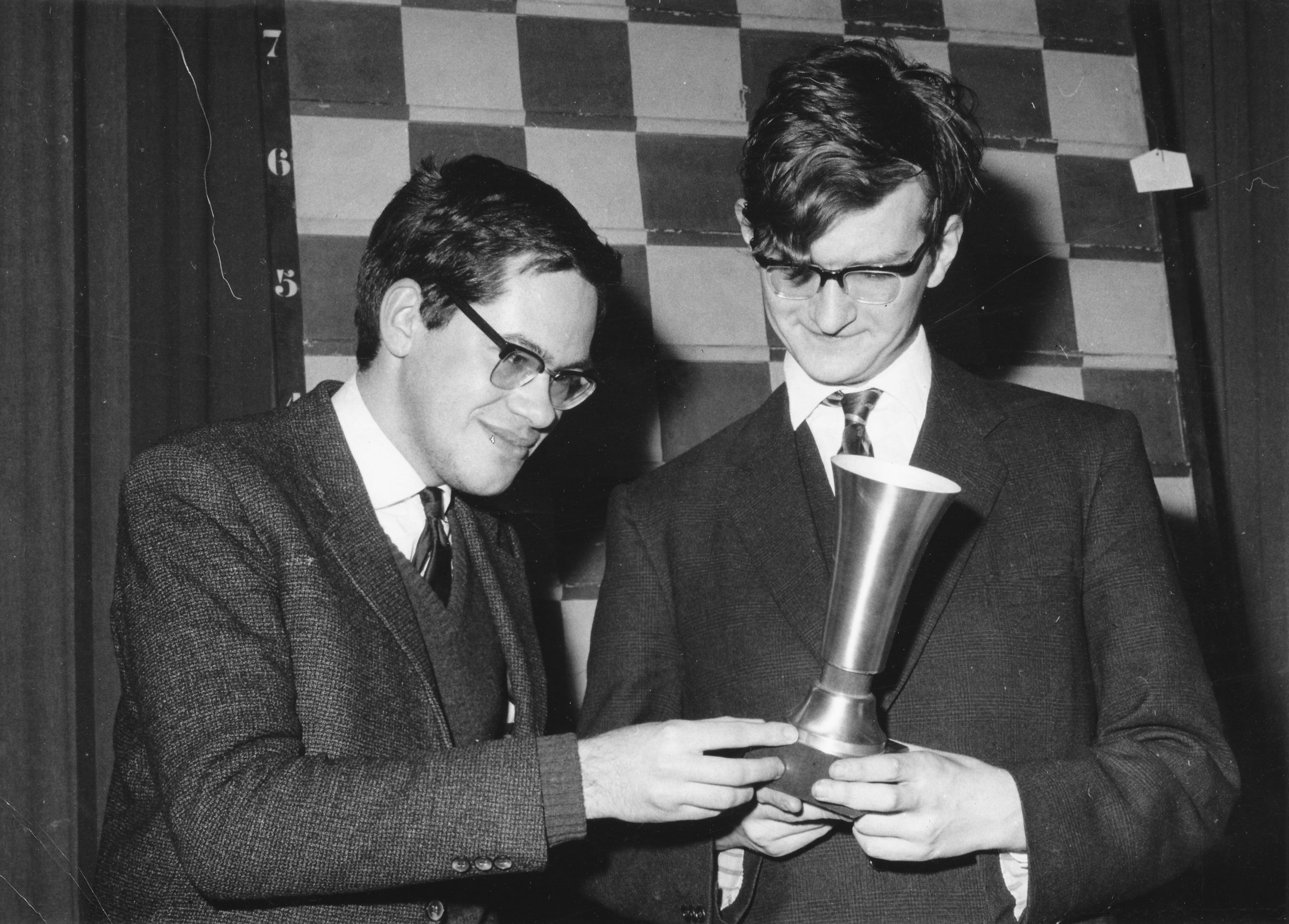 Hans Ree (left) and Andrew Whiteley (right) examine the European Junior Trophy for 1965/6 in which they tied for first.
