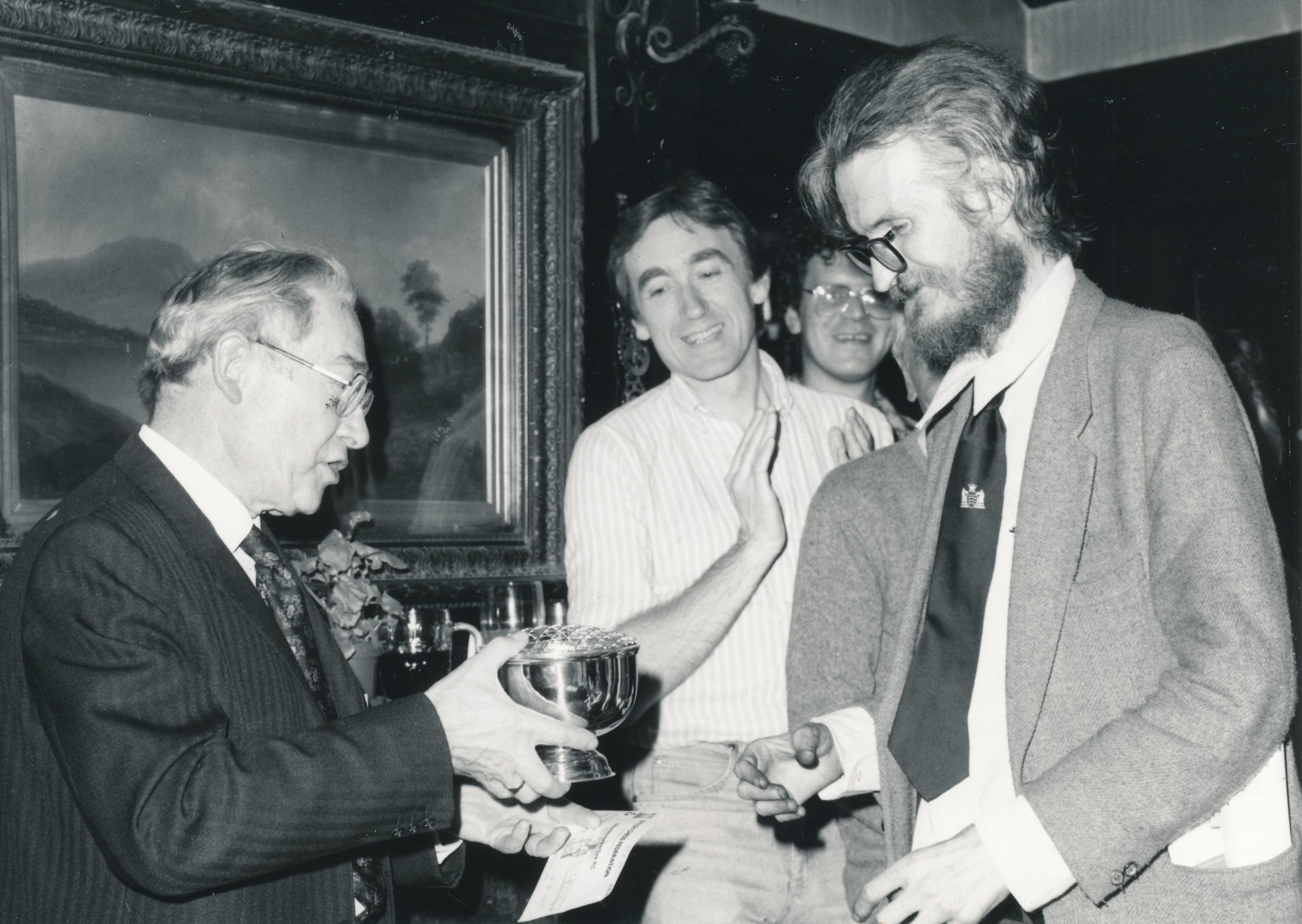 Andrew Whiteley receives the Rosebowl trophy from John Poole