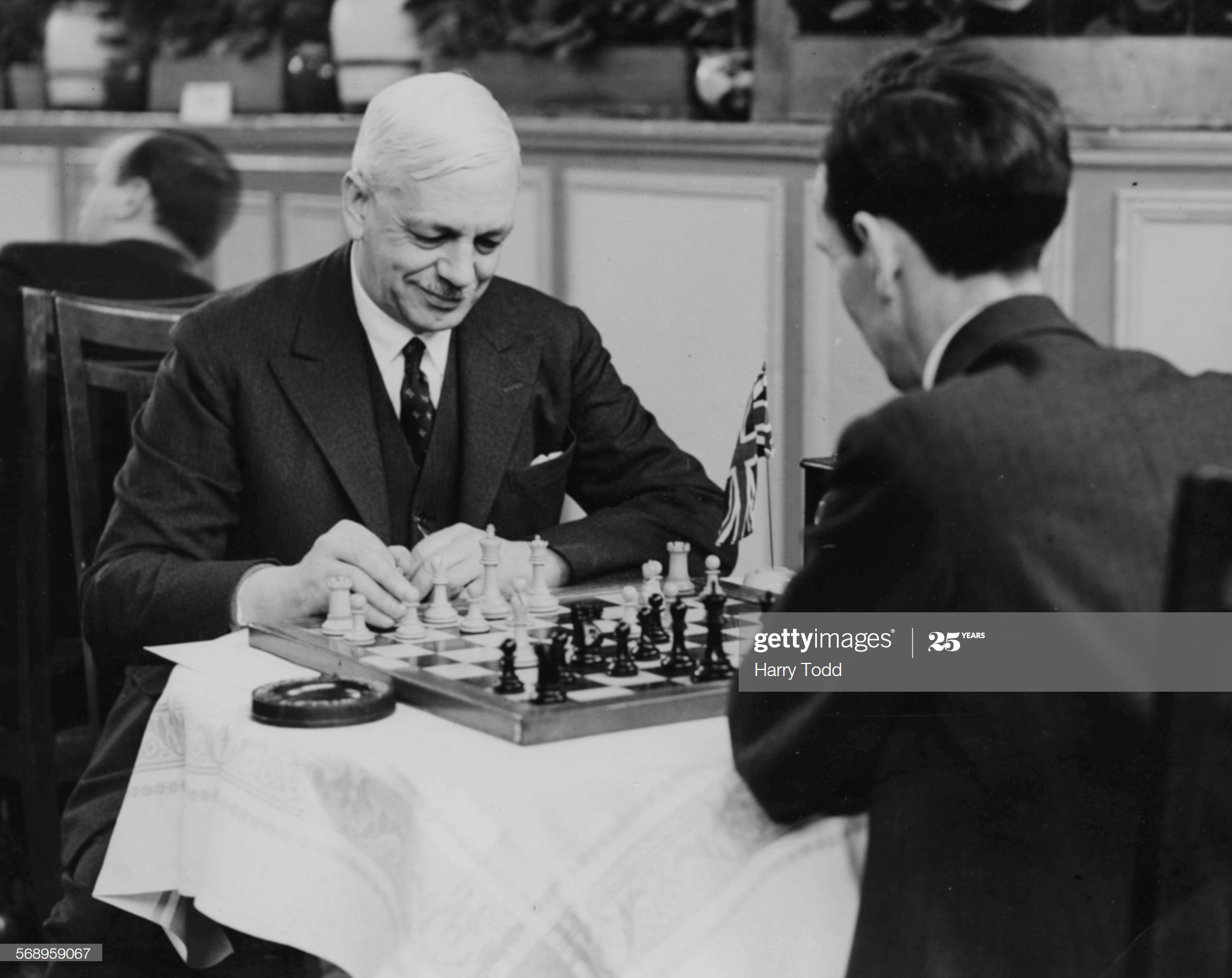 Sir George Thomas And Brian Reilly Sir George Thomas (left), leader of the British chess team, playing Irishman Brian Reilly at the Easter Chess Congress, Margate, April 24th 1935. (Photo by Harry Todd/Fox Photos/Getty Images)