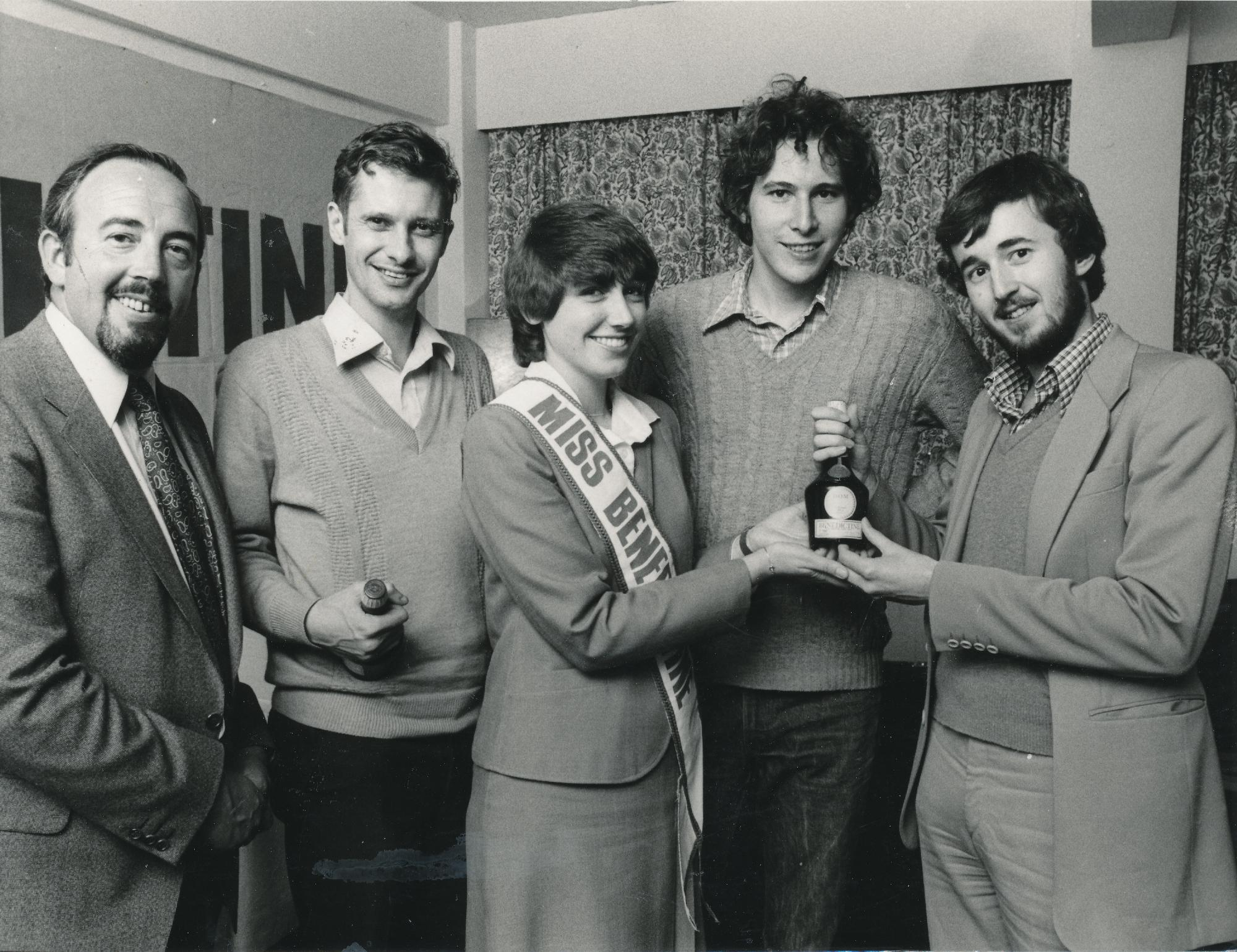 Nigel receives a much welcome prize (in Manchester) from Miss Benedictine in 198?