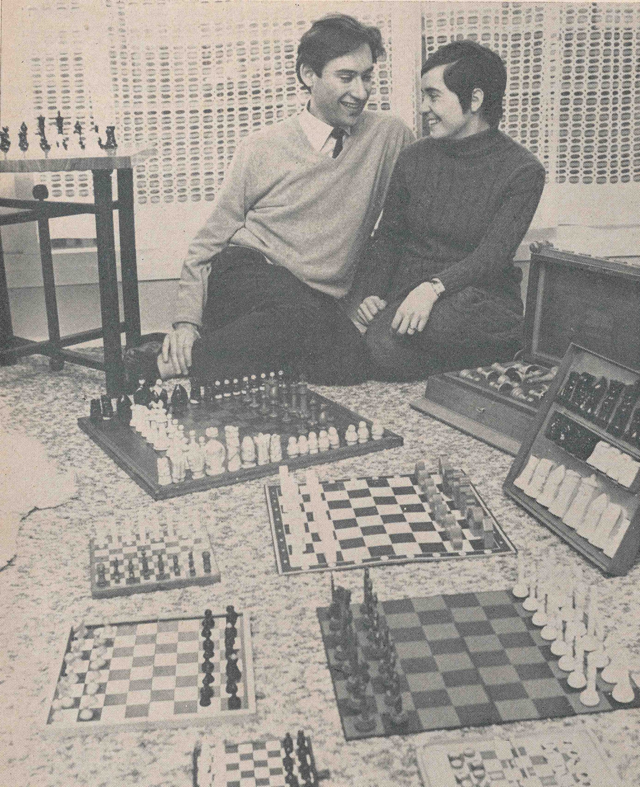 Bill and Jana Hartston are shown with some of their many chess sets. CHESS, August 1973, page 323