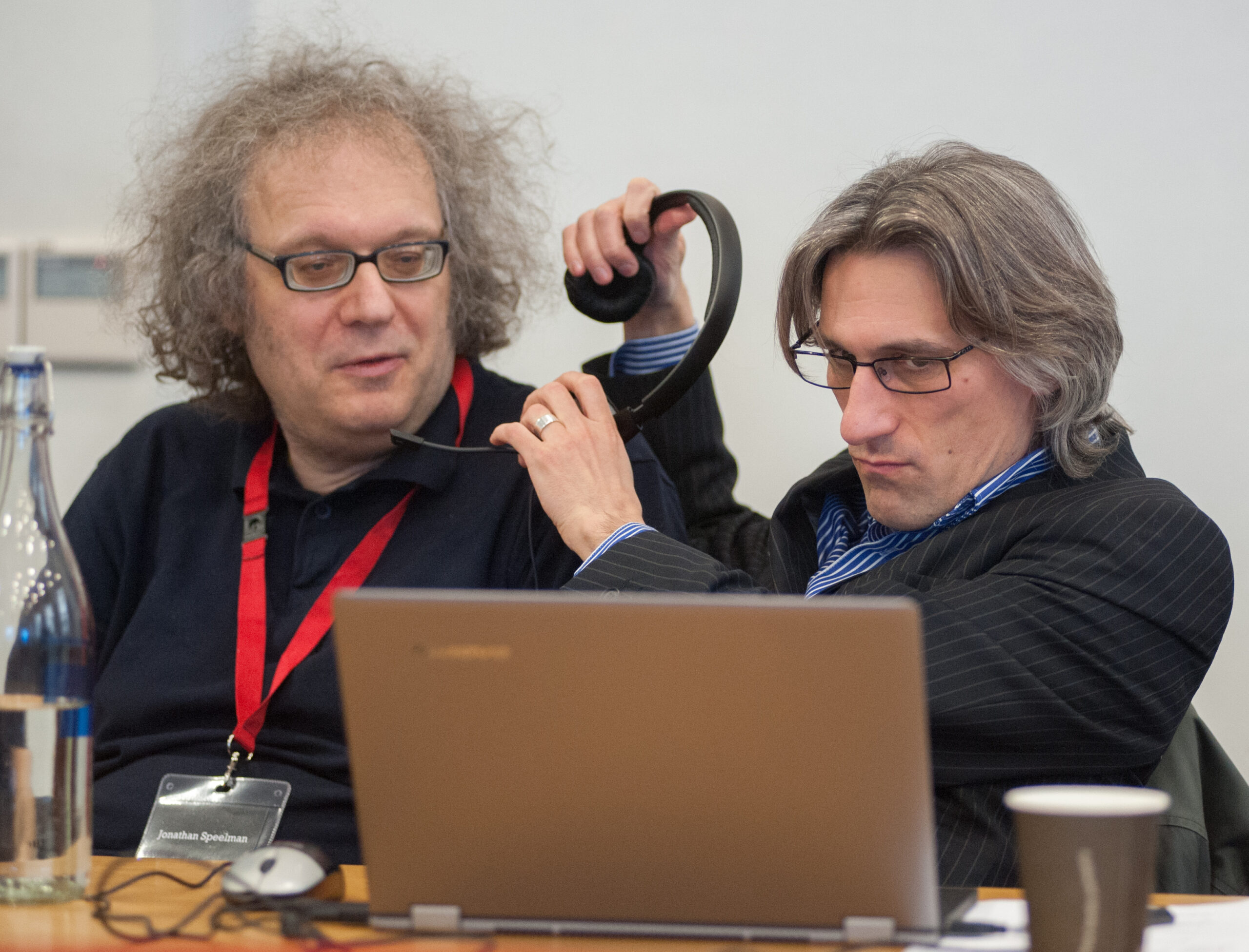 Jonathan Speelman and Daniel King share headphones at the 2013 FIDE Candidates event in London, courtesy of John Upham Photography