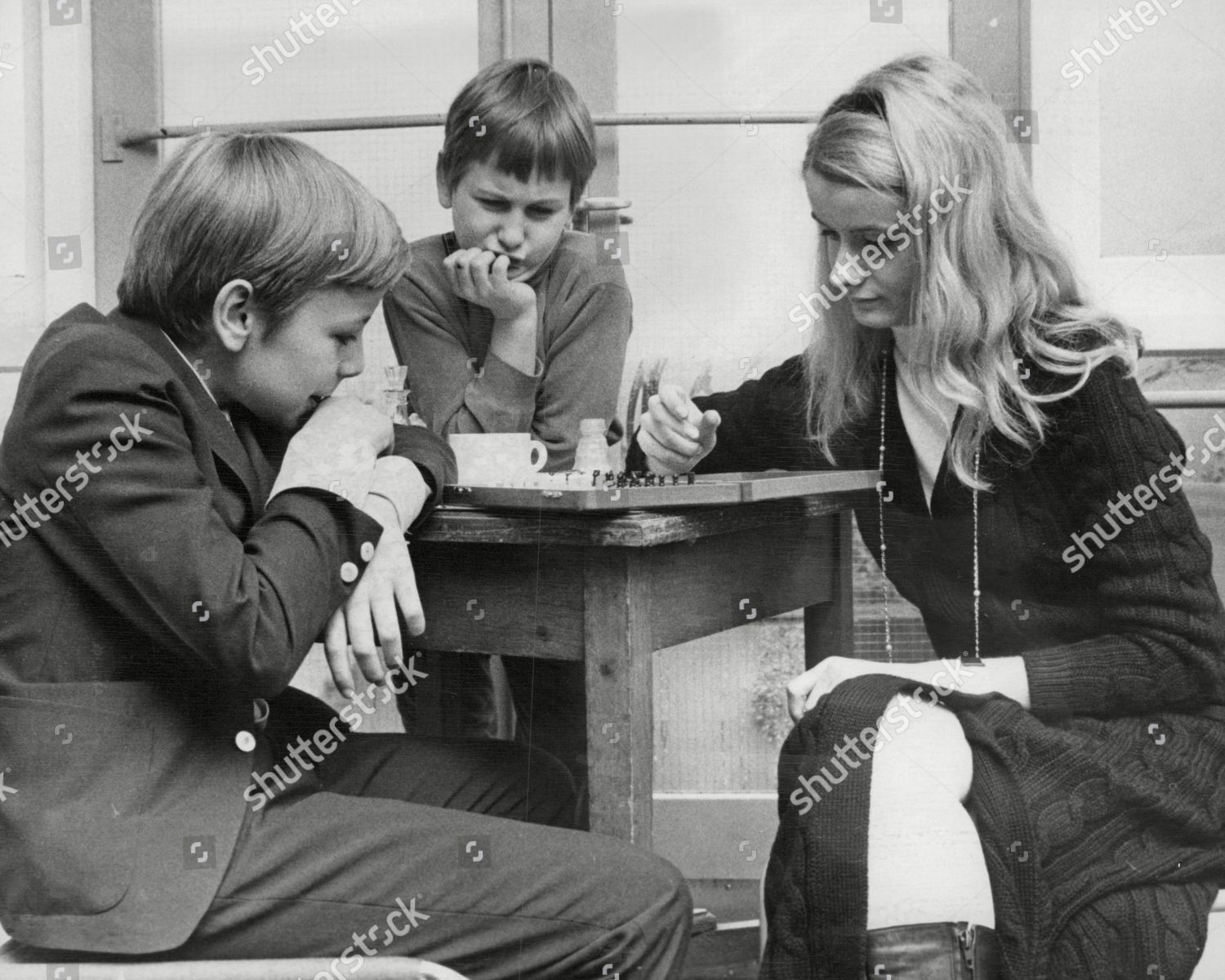 English Chess Champion Dinah Dobson Playing Against Two German Boys During Lunch-break At Chess Competition In Hastings. Box 658 221121512 A.jpg. English Chess Champion Dinah Dobson Playing Against Two German Boys During Lunch-break At Chess Competition In Hastings. Mandatory Credit: Photo by ANL/Shutterstock