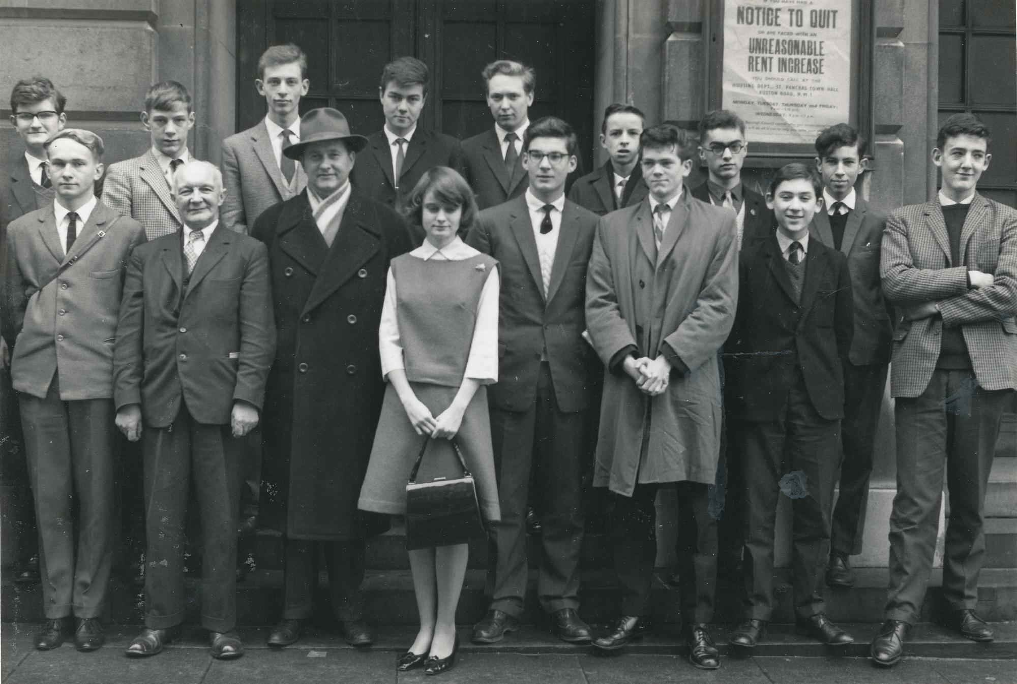 Some of the participants in the Paul Keres  display on November 25th, 1962, at St Pancras Town Hall, London WC1. Back row : AJ. Whiteley, D. Floyer, PJ Collins, PJ Adams, RC Vaughan, KB Harman, D. Parr, DNL Levy, Front row : MV Lambshire, AE Hopkins (selector) Paul Keres, Miss D. Dobson, RE Hartley, BC Gillman, WR Hartston  and PN Lee. Photograph by AM Reilly. Source : BCM, 1963, page 13