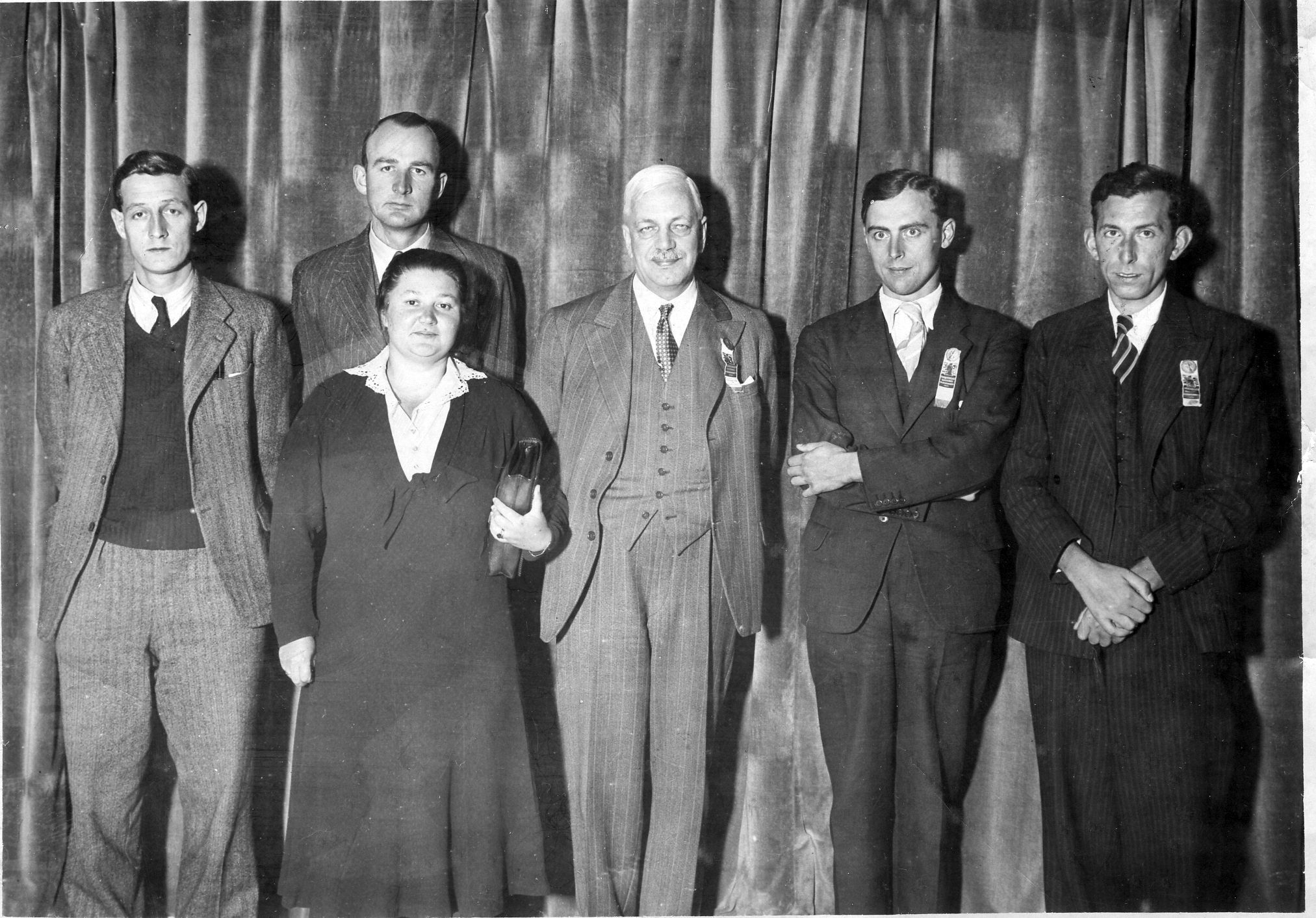 Left to right Baruch H Wood, Philip Stuart Milner-Barry, Vera Menchik (playing in the women's world championship (held concurrently with the 1939 Buenos Aires Olympiad) which she won with 17 wins and 2 draws), Sir George Thomas, Conel Hugh O'Donel Alexander and Harry Golombek. England withdrew after their preliminary group due to the outbreak of war despite qualifying for the top final. Thanks to Leonard Barden