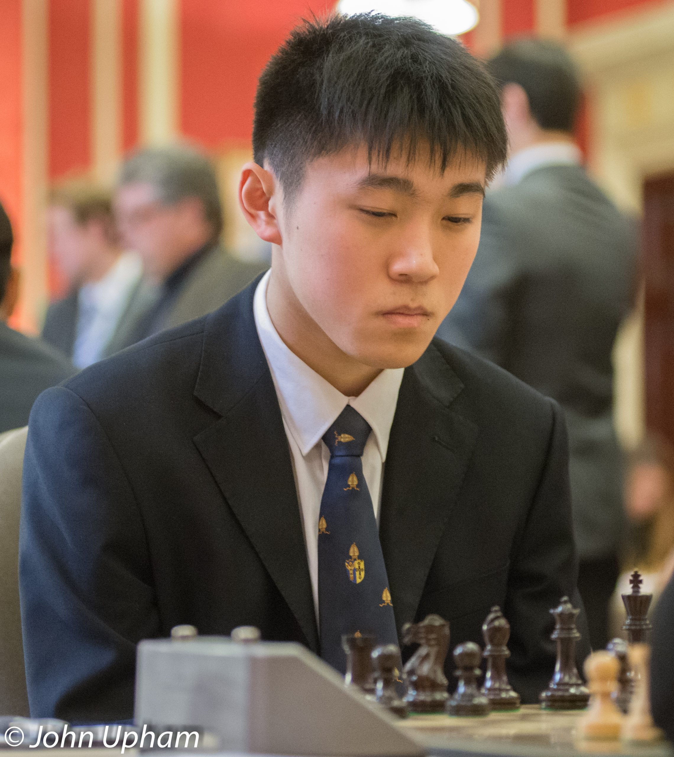 Yang-Fan Zhou plays board one in the 2014 Varsity Match, courtesy of John Upham Photography