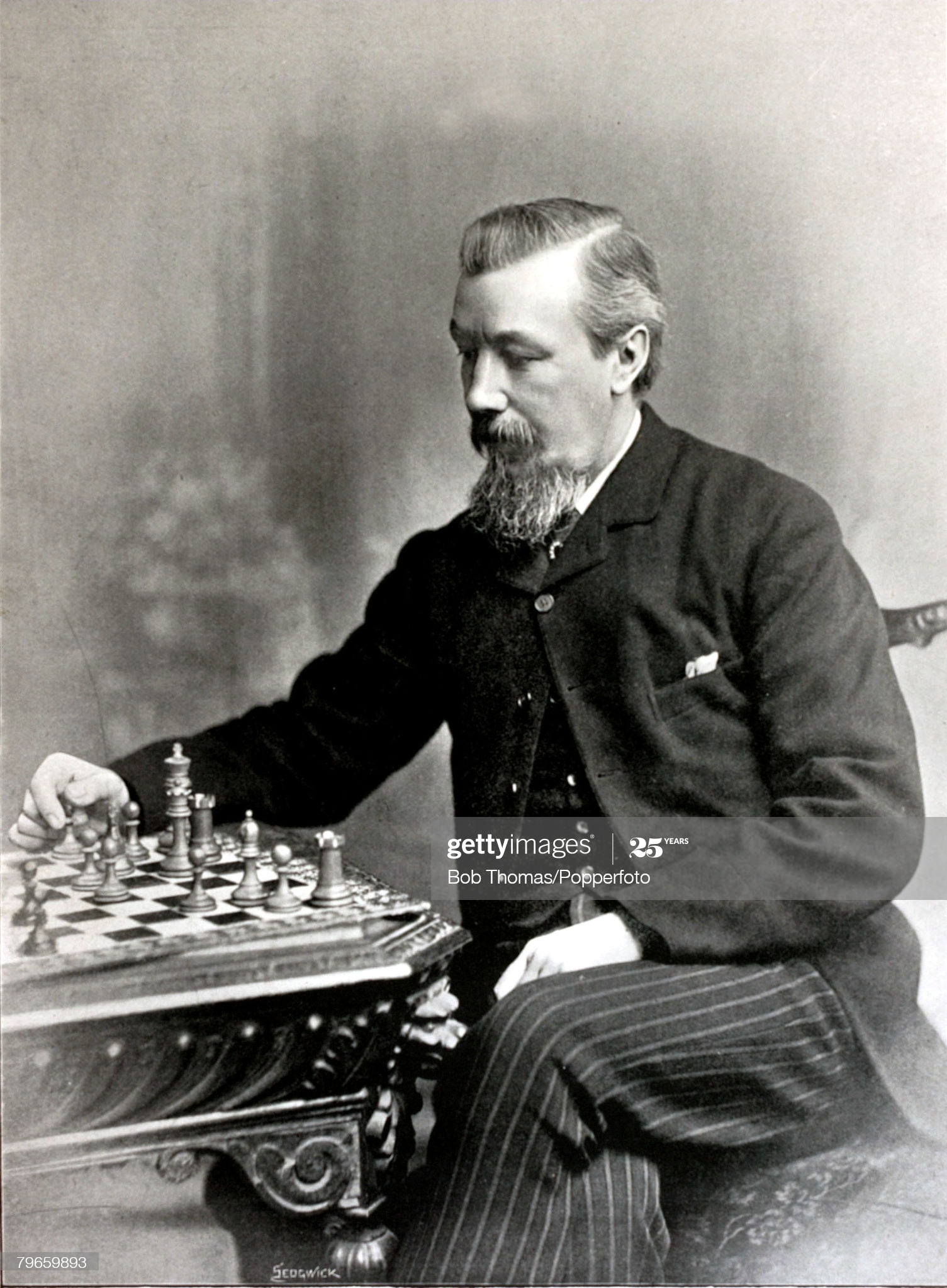 Chess, circa 1896, J,H,Blackburne, well known chess player, who had toured both on the Continent and America,able to make between 40 to 60 moves when blindfolded by sheer memory  (Photo by Bob Thomas/Popperfoto via Getty Images/Getty Images)
