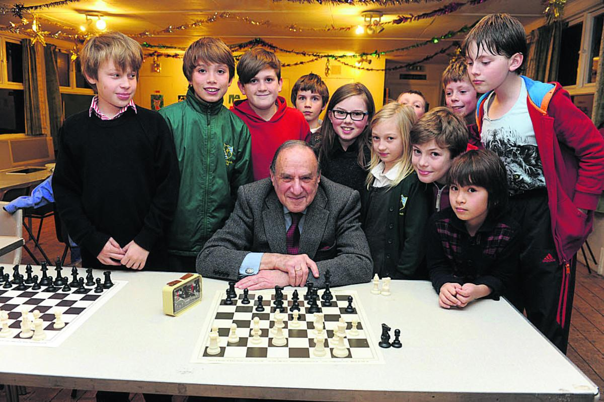 Mr Sherwin, 80, met and played against the new members of Bradford & Avon Valley Youth Chess Club on their opening night at St Nicholas Hall on Tuesday. Photo courtesy of The Wiltshire Times