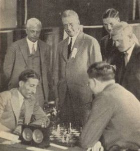 Worcester, circa 1931: Mir Sultan Khan (left) plays Theodore Tylor, while Sir George Thomas (far left) and Arthur Mackenzie (far right) spectate. Photo courtesy of Britbase.