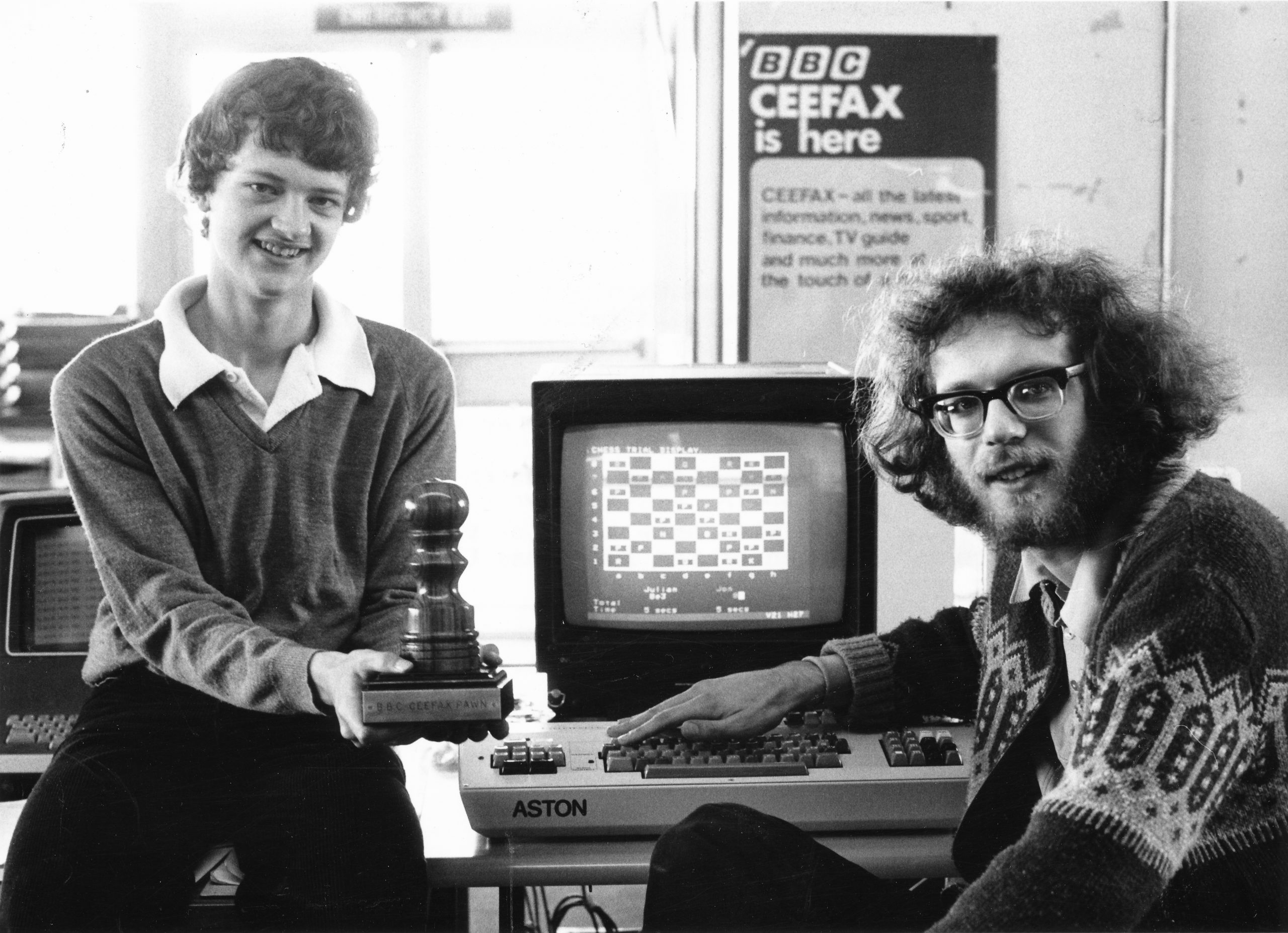 Julian Hodgson and Jonathan Speelman prepare to play each other at their own home via CEEEFAX. This was organised by Peter Andrews of BBC Chess Club and was the first match of its kind.