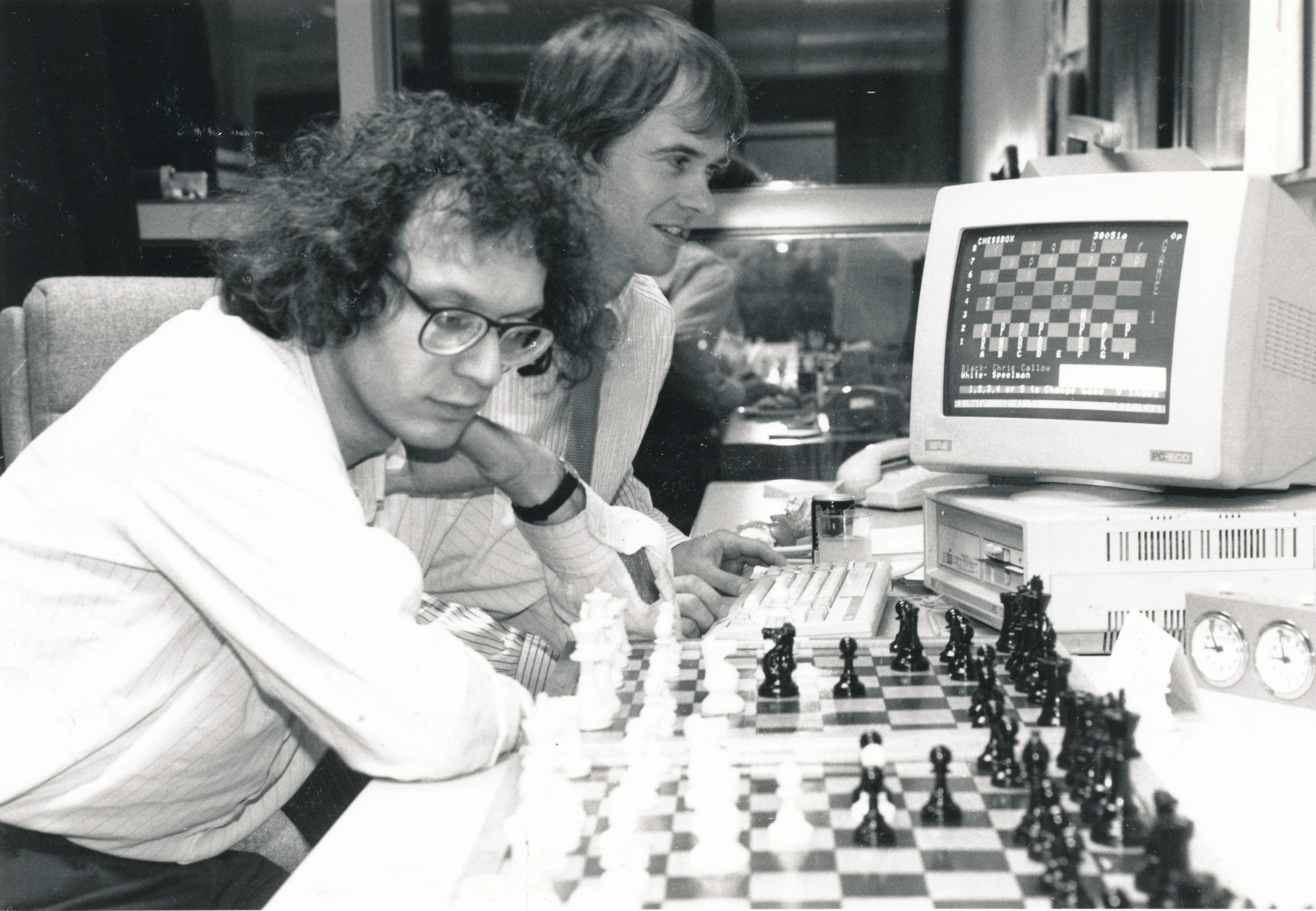 Grandmaster Uses PressTel Chessbox to Play Long Distance Chess. Jonathan Speelman the UK Grandmaster is pictured here deciding his next move in a computer chess game against five simultaneous opponents. Players exchanged moves online via the ChessBox club on PressTel, BTs videotex service.