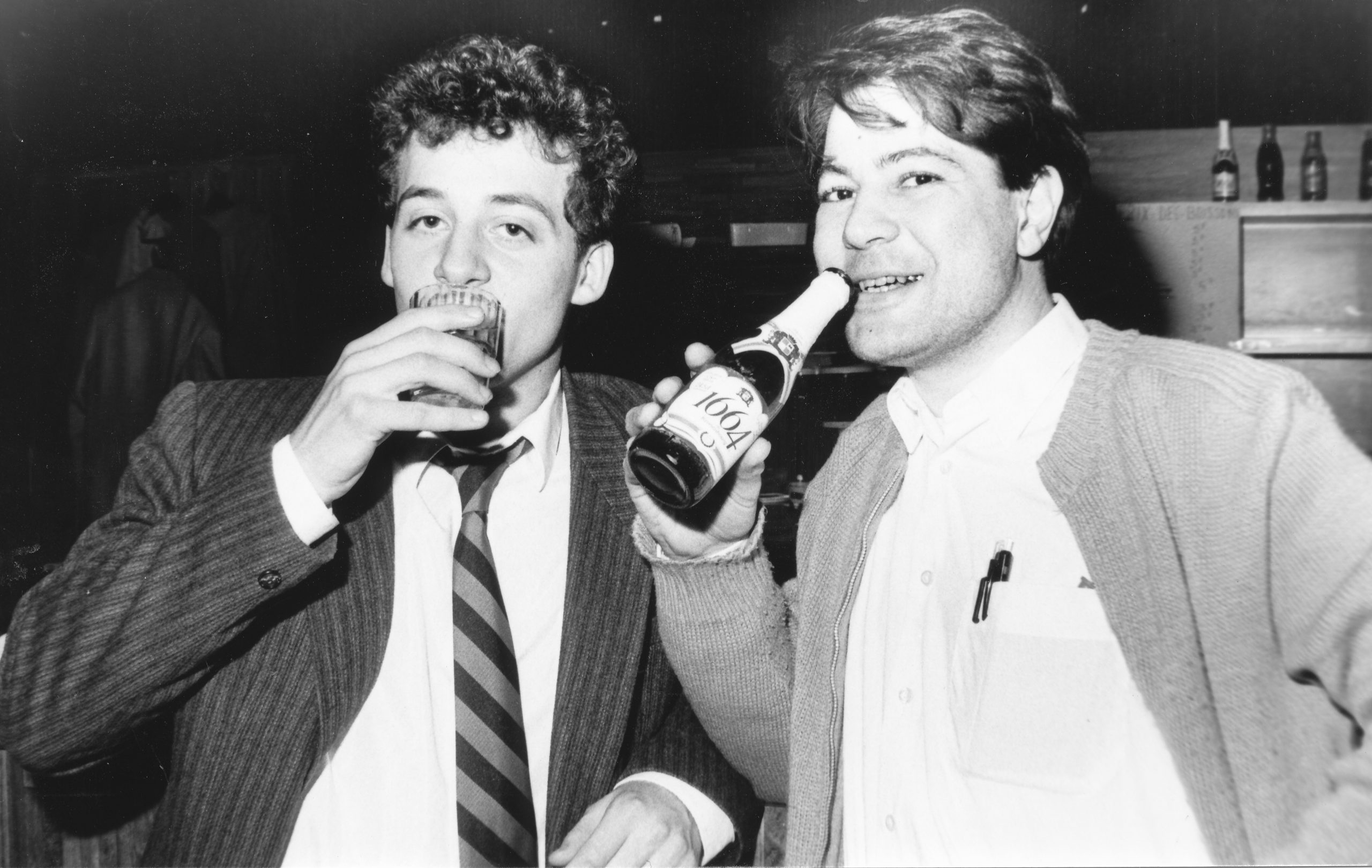 IM David Norwood and IM Aldo Haik (France) taking a drink at the bar during Cappelle-Le-Grande, 1988. Photograph by Caroline Winkler