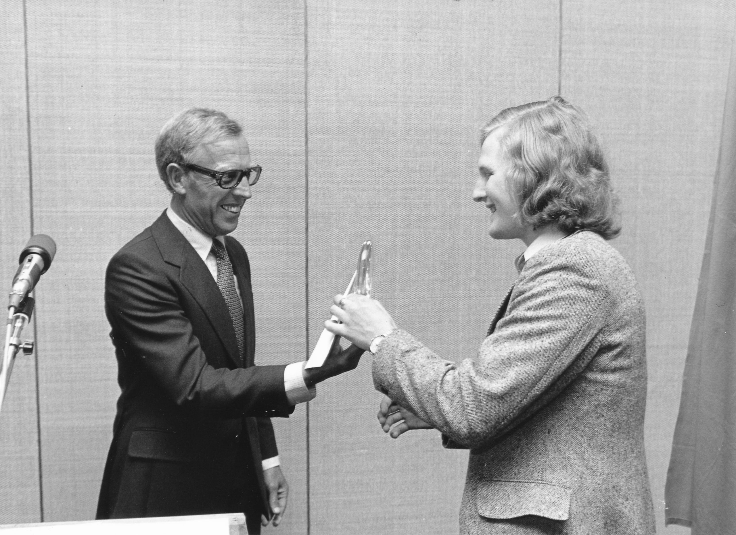 Tony being presented with the trophy in the photograph below