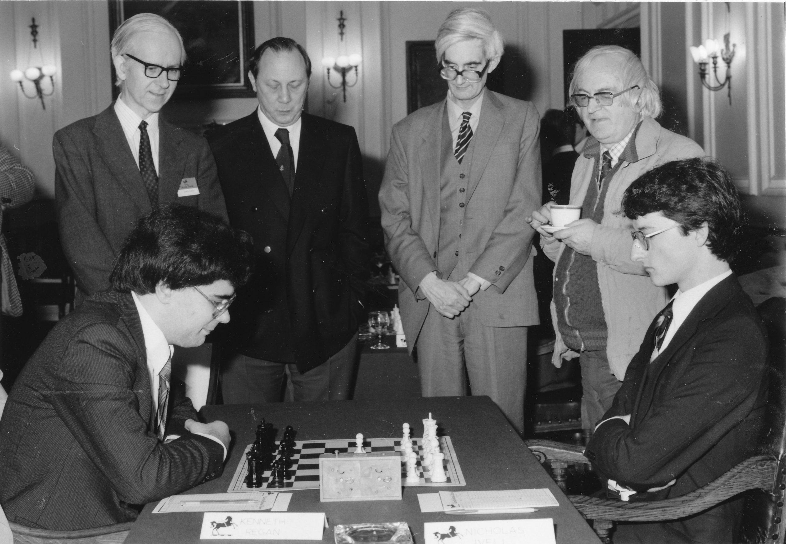 Leonard Barden, Henry Mutkin, Adrian Hollis and Bob Wade observe Nick Ivell vs Ken Regan at the 1983 Varsity match