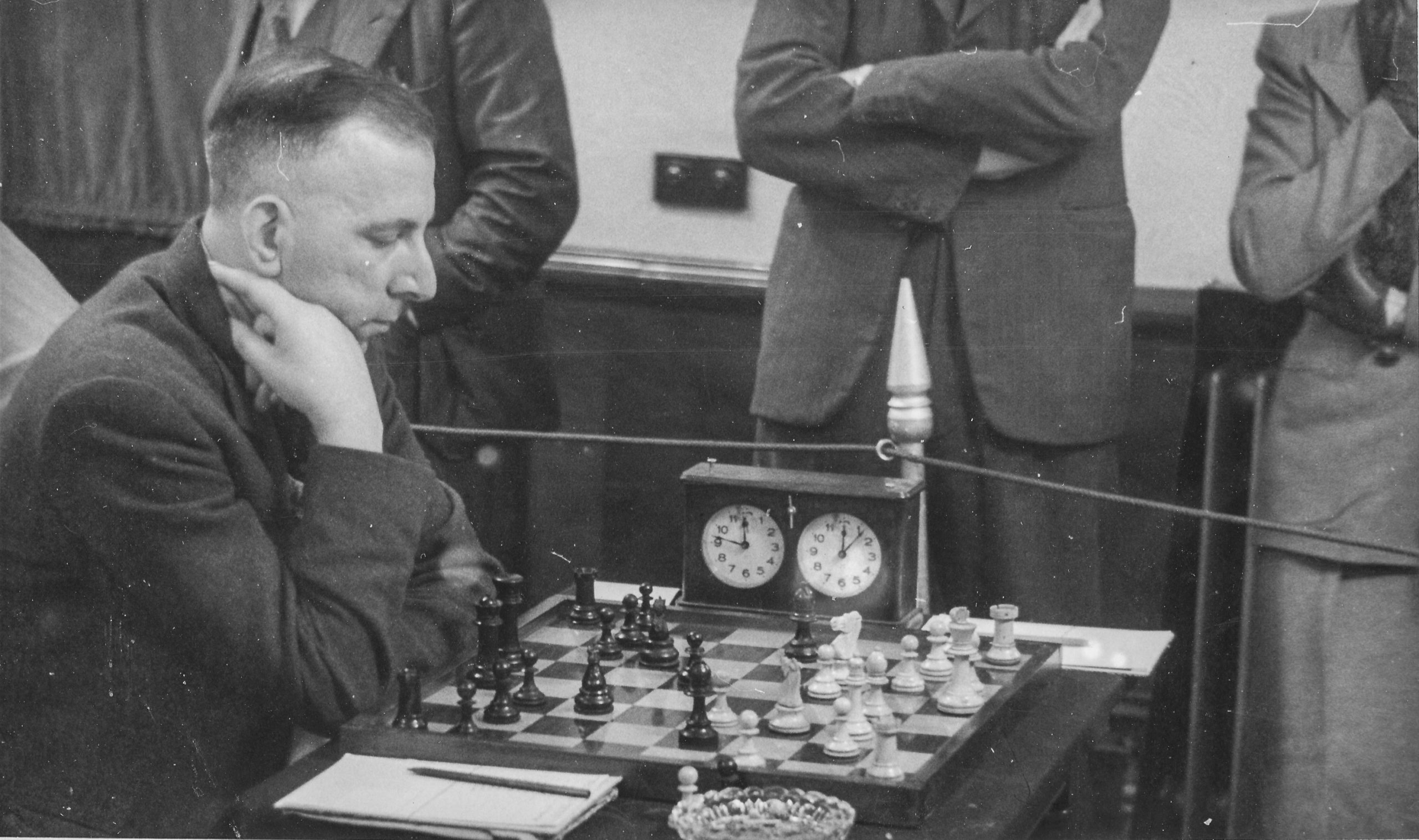 Harry Golombek contemplates his options after White (JH Donner) played 9.a3 in the 1952 Anglo-Dutch Match. Donner won in 33 moves and the game was BCM #11,074