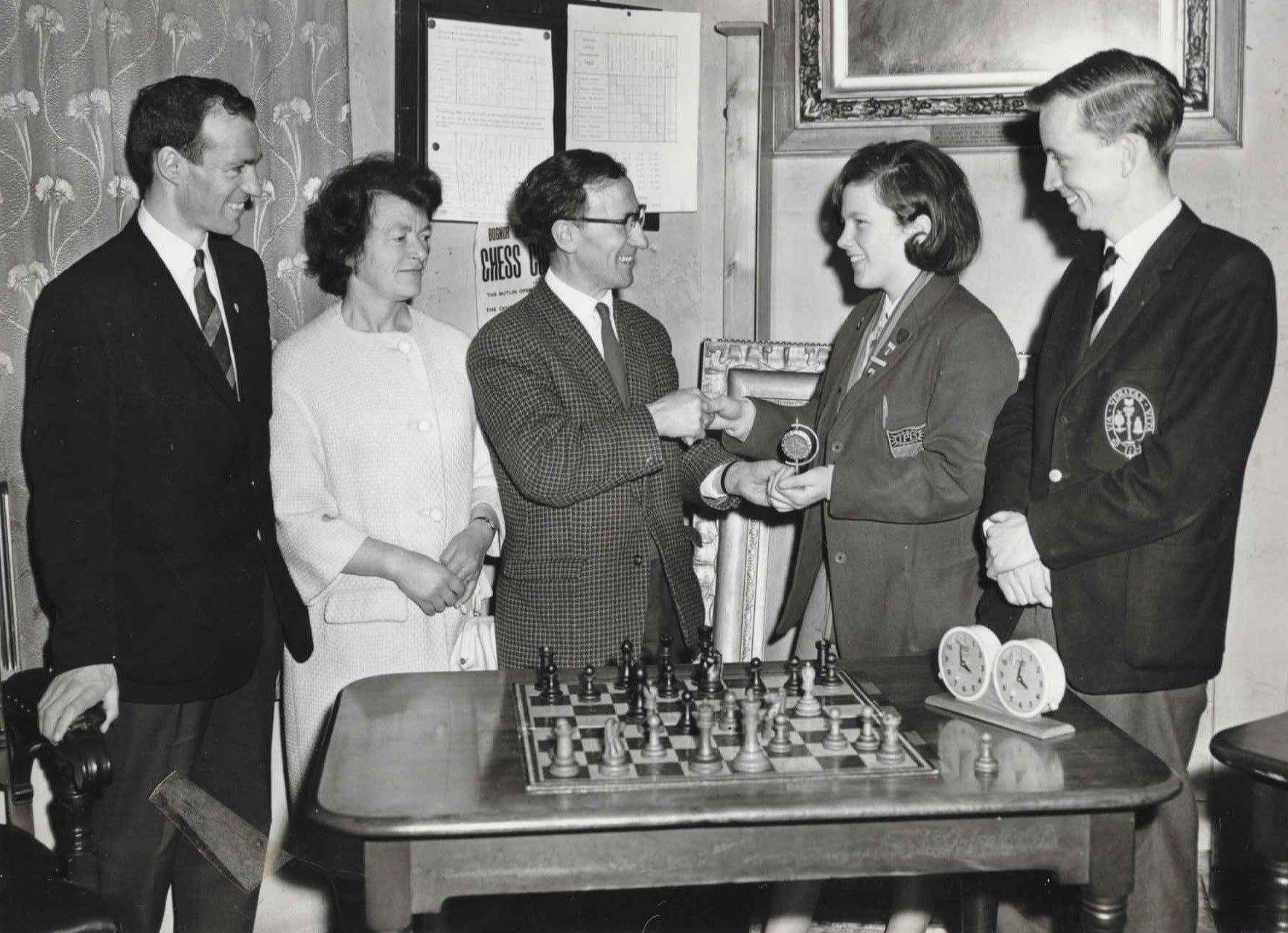 Prizegiving at the 1966 Scottish Championships. From the left: Michael Fallone, Nancy Elder, W.P. McColl, President of Dundee Chess Club, Kathleen Patterson, Gerald Bonner. Courtesy of Chess Scotland