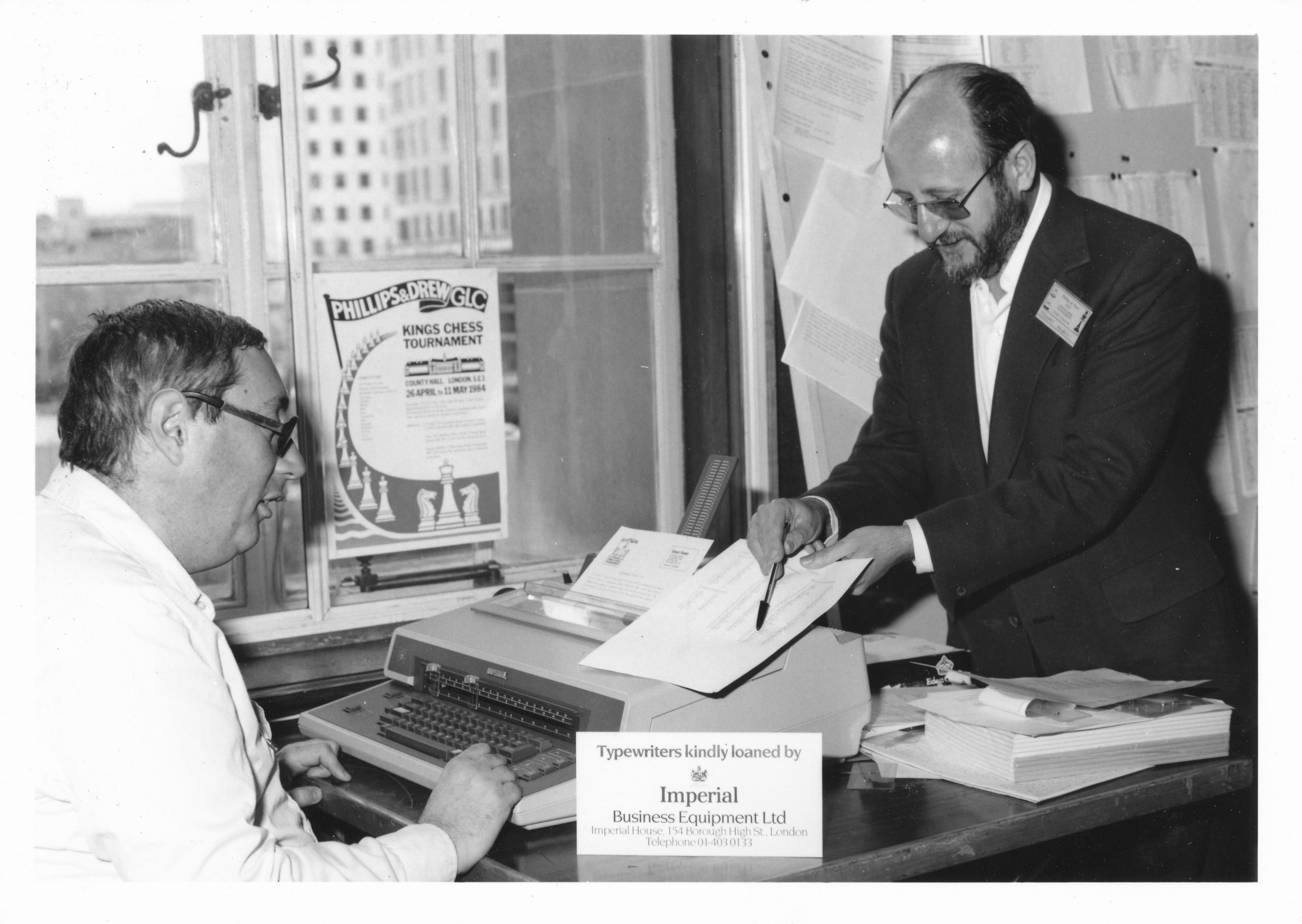 Richard W. O'Brien and Stewart Reuben working on a bulletin