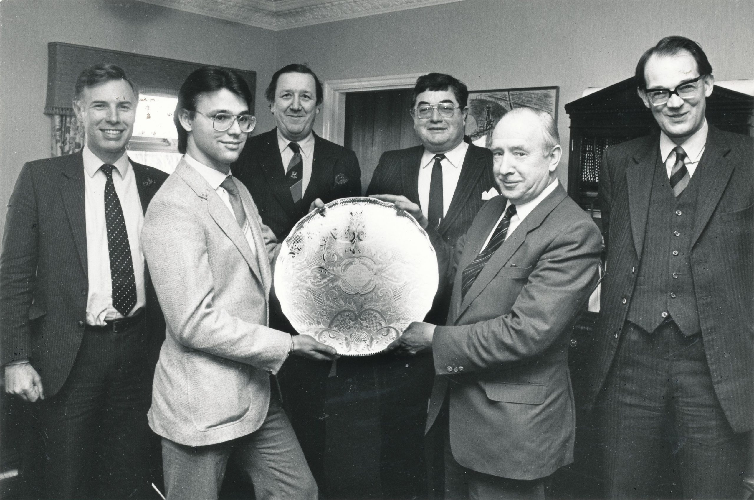 Jim accepts the 1981 Grand Prix shield from David Anderton OBE