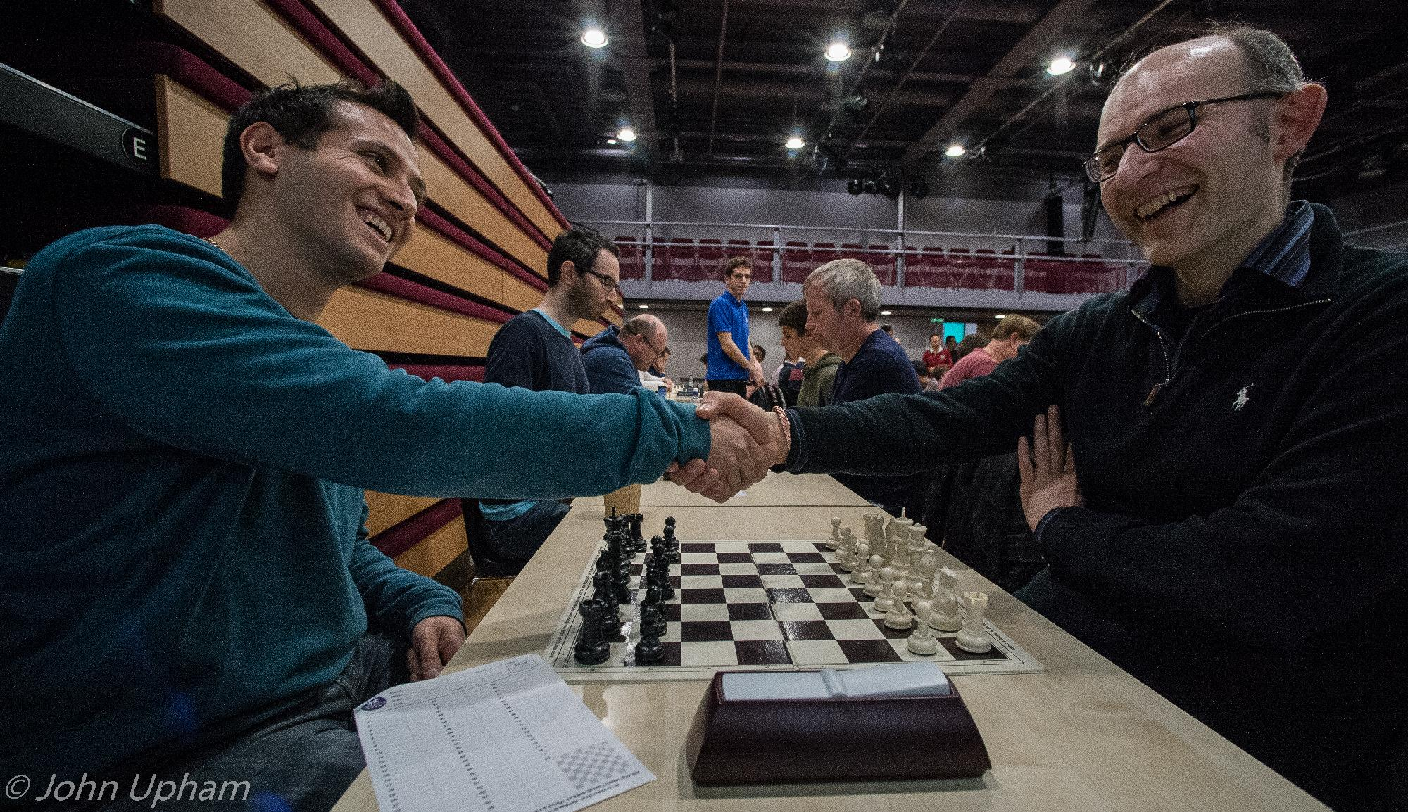 IM Lorin D'Costa at GM Matthew Sadler at the 2017 Michael Uriely Memorial Tournament, courtesy of John Upham Photography