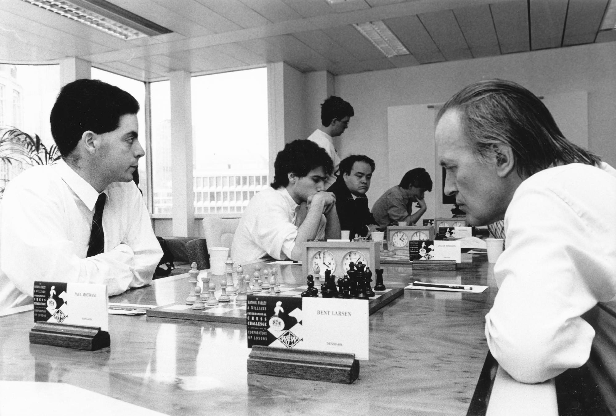 Paul Motwani plays Bent Larsen at the 1990 Watson, Farley and Williams International Chess Challenge. The game was a 3.Lb5 sicilian which was drawn