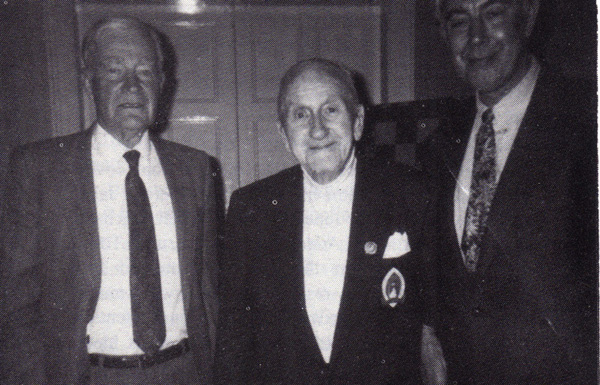 Source: The Problemist, May 1996. Photo taken March 1996 at the Mansfield Centenary Meeting at Paisley, when Barry Barnes delivered a lecture on Comins Mansfield. Left to right: Geoffrey Mansfield (son of Comins), Robert Gray and Barry Barnes, International Master of Chess Composition.