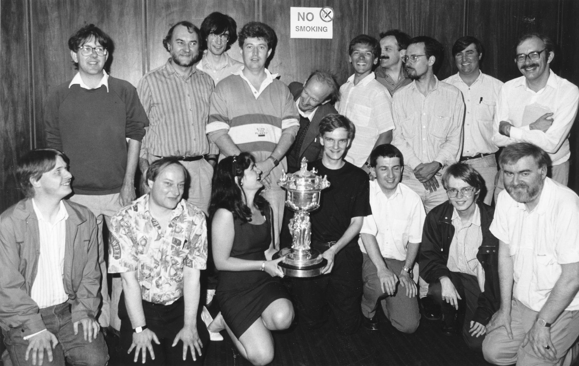 Lawrence Cooper (centre with trophy) being presented with 1992 BCF Counties Championship trophy by WIM Cathy Forbes. Others in the group include Michael Gough, Alan A Smith, Gerald Acey, Mike P Townsend, Malcolm Armstrong, Martin Costley, Alan Crombleholme, Graeme N Buckley, Paul Wallace, Mark A . Wheeler, Dave Carless, Darren P Wheeler, Keith Thompson, Ralph MA Allen and Graham Smith