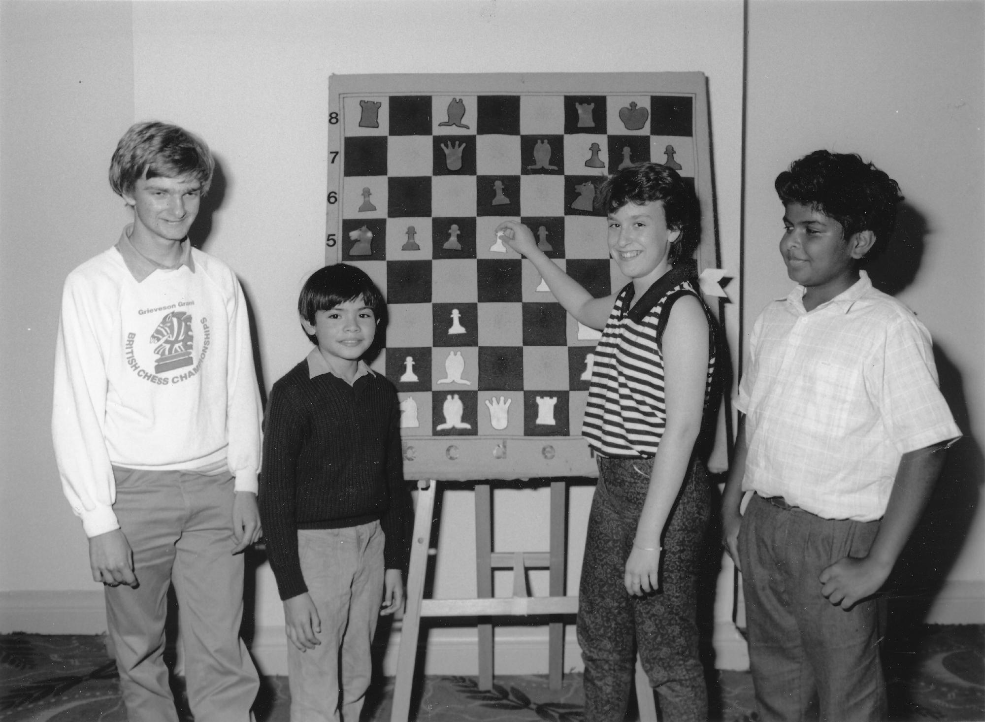 Lawrence Cooper, Demis Hassabis, Cathy Haslinger and Dharshan Kumaran in around 1986. Possibly at a Lloyds Bank event.