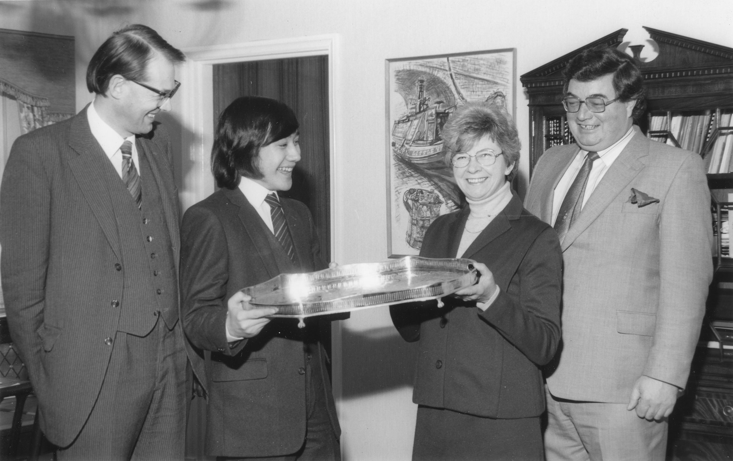 Mrs. Joan Agar; Chairman of Leigh Interests, presents the Leigh trophy (for 1981) to Mark Hebden. Left, David Anderton, BCF President; on the right Malcolm Wood, Leigh's Chief Executive. BCM, 1981, page 104