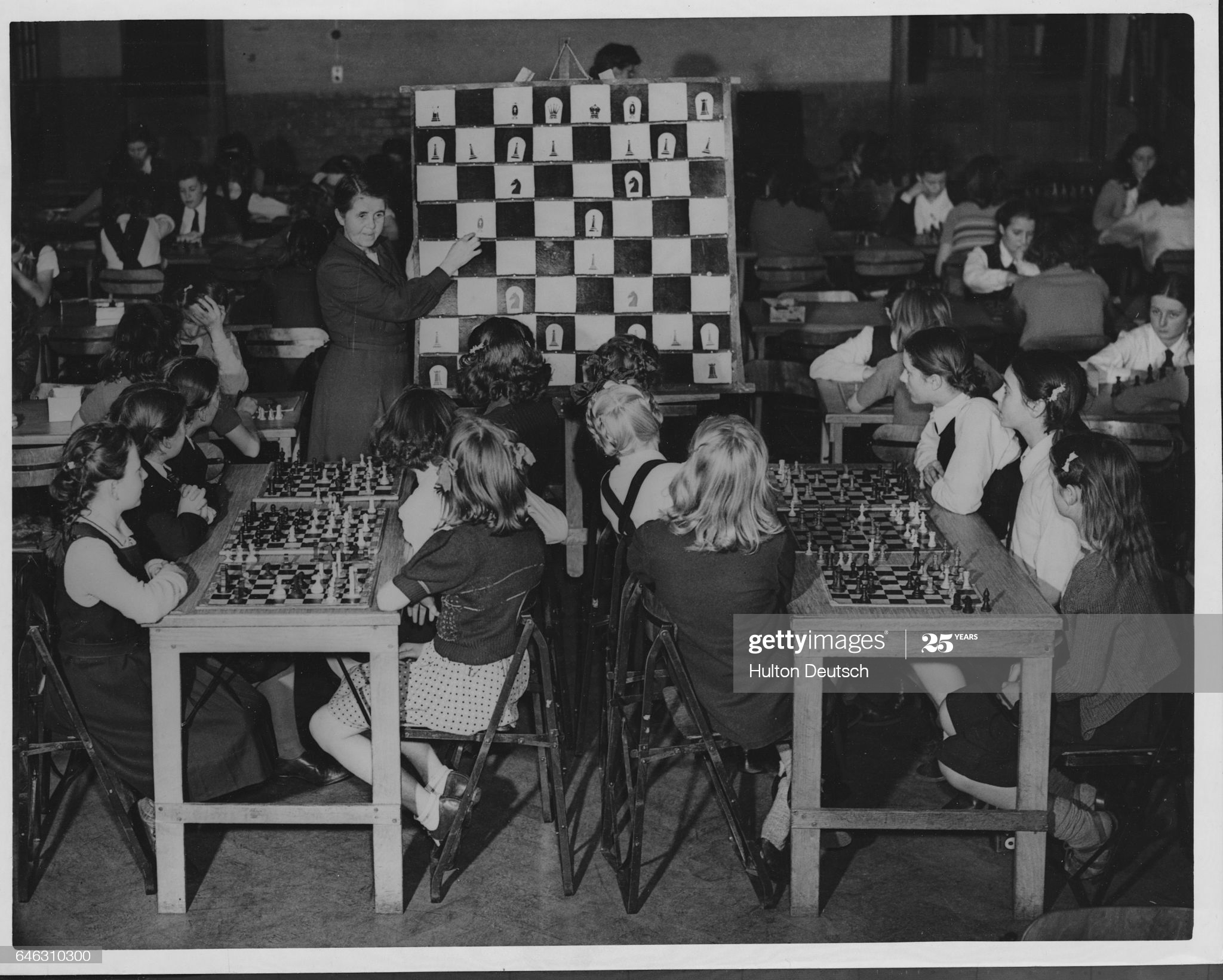 A class of girls listens to their teacher Lucy Anness give a lesson on the game of chess at a school in Bromley, Kent, England, in 1948. Miss Anness, head of the school, believes this is the only girls' school in Britain at this time that teaches chess as part of the curriculum. (Photo by © Hulton-Deutsch Collection/CORBIS/Corbis via Getty Images)
