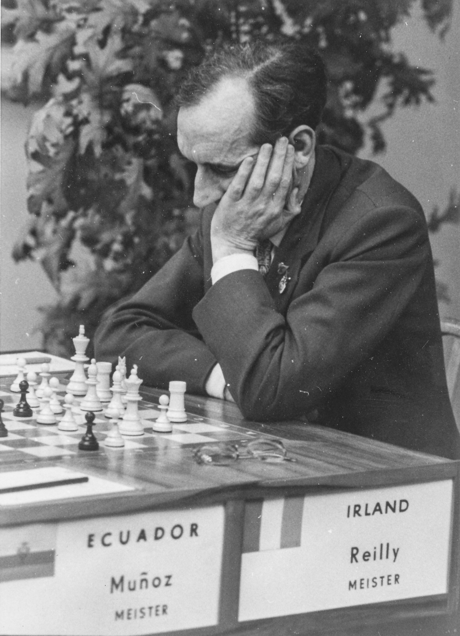 Brian Reilly playing Cesar Munoz (Ecuador) in round 8 of the Leipzig Olympiad played on 23rd October 1960. The game was drawn in 48 moves.