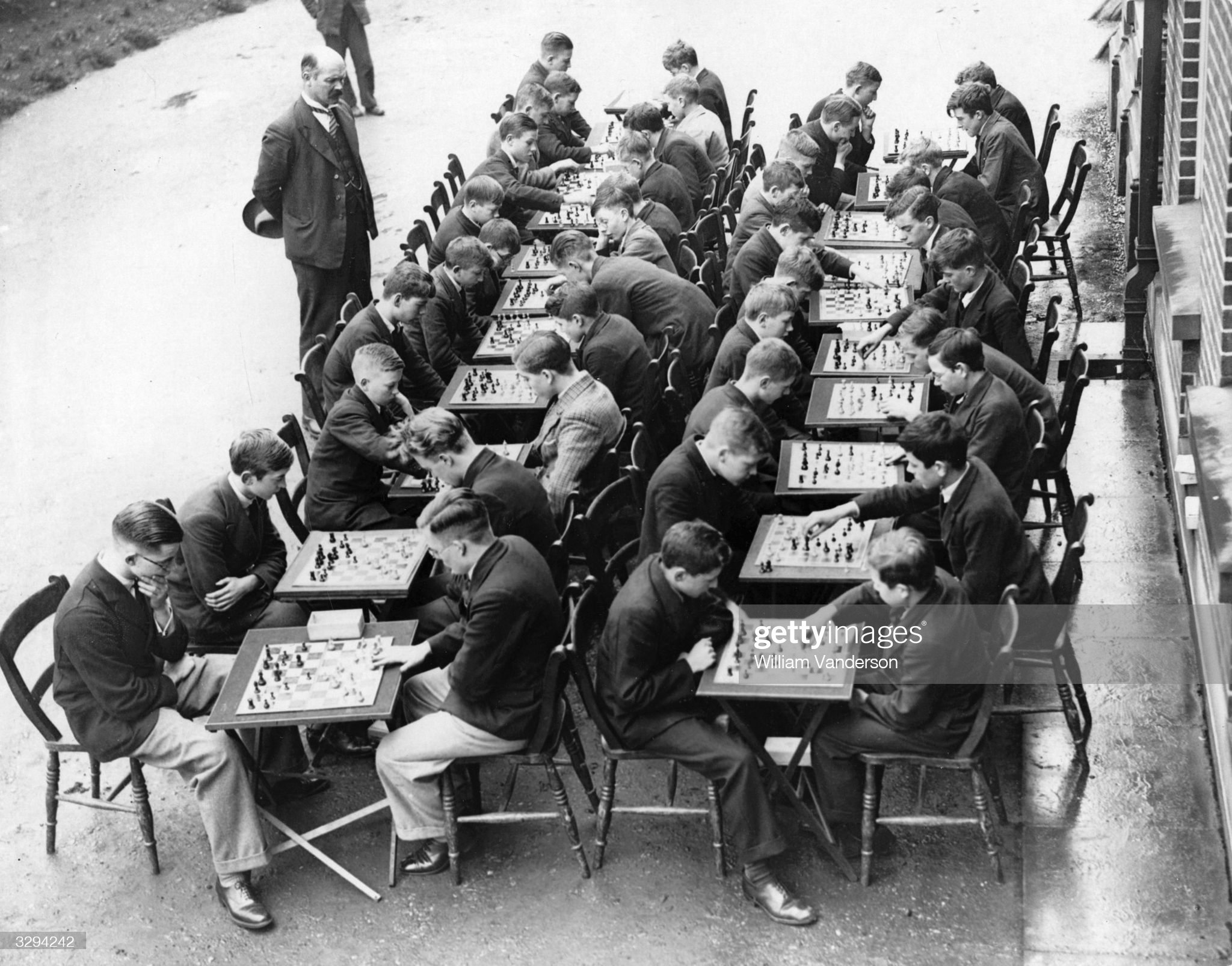 Chess Tournament 19th November 1934: An inter-form chess match for the pupils is in progress at Wednesbury High School for Boys, supervised by Mr C S Kipping, their headmaster. (Photo by William Vanderson/Fox Photos/Getty Images)