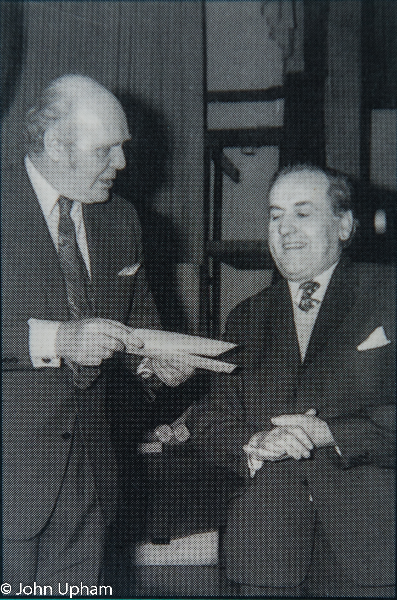 Alan Phillips (riight) receives his prize from television celebrity and magician David Nixon for his equal second placing at the 1973 Islington Open, photographer unknown