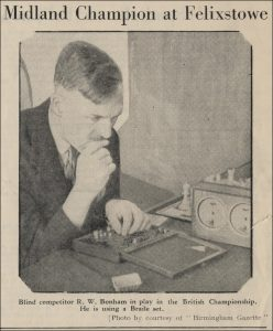 Blind Competitor RW Bonham in play in the British Championship. He is using a Braille set. Courtesy of Michael Clapham from https://chessbookchats.blogspot.com/2020/03/british-championships-felixstowe-1949.html